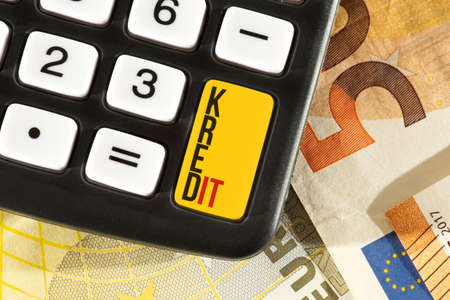 Calculator, euro banknotes and a loan Banque d'images