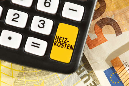 Euro banknotes, calculators and heating costs