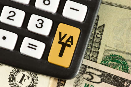 Calculator, dollar bills and sales tax VAT in America