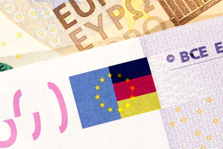 Euro banknotes and flag of Germany Banque d'images