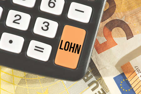 Calculator, euro bills and the wages