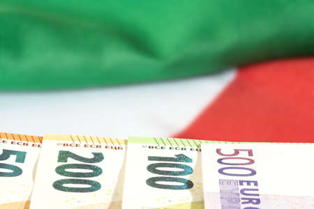 Flag of Italy and Euro banknotes