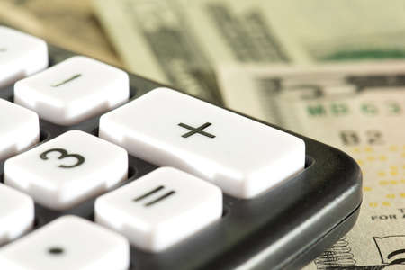 Dollar bills and a calculator