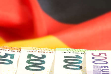 Flag of Germany and Euro banknotes Banque d'images