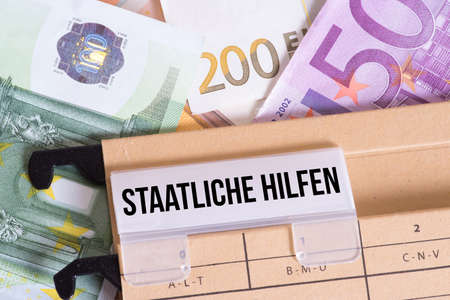 Euro banknotes and folders State aid Banque d'images