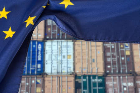 Container in the port and flag of the European Union EU