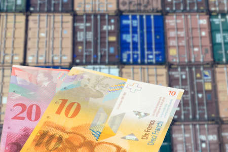 Containers in the port and Swiss franc money