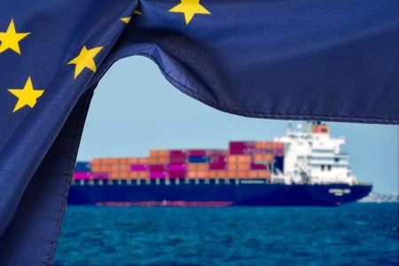 European Union EU flag and a container ship Reklamní fotografie