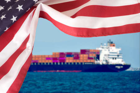 A container ship and the flag of USA