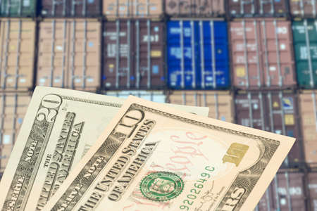 Containers in the port and dollar bills