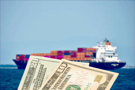 A ship with containers and dollar bills