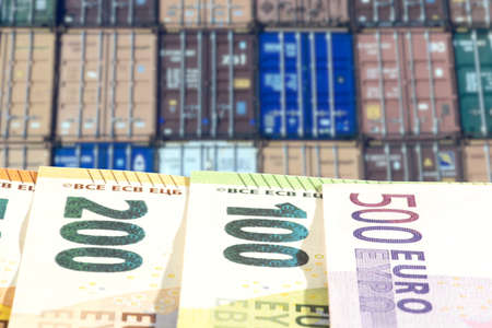 Containers in the port and euro banknotes Reklamní fotografie