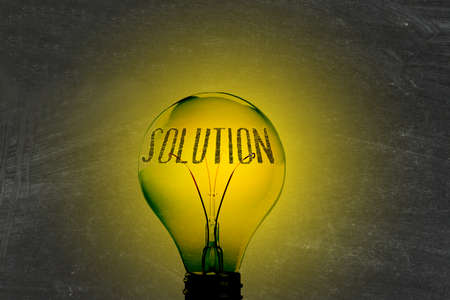 Light, lightbulb and the word solution