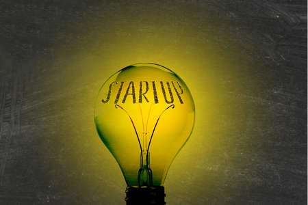Light, lightbulb and the word startup