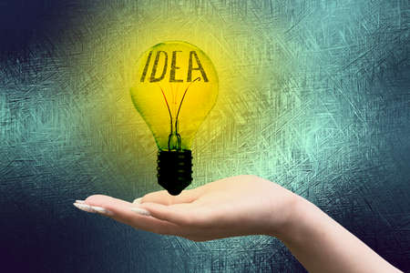 A hand, a lightbulb and an idea