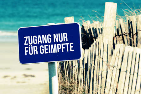 A beach and note access for vaccinated only Reklamní fotografie