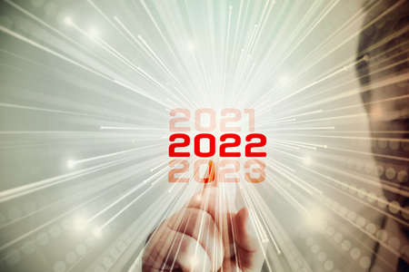 A man points to the year 2022 Reklamní fotografie