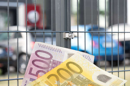 Car dealership, new cars and euro banknotes