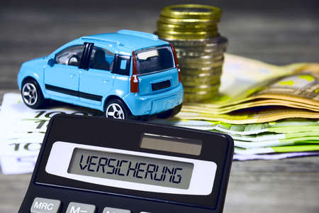 Car, euro bills and coins and calculator insurance