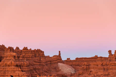 moab: Sunset over a rock face in Moab