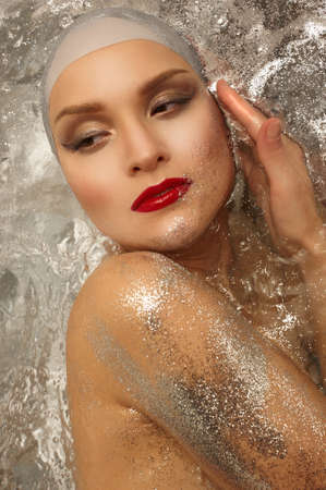 beaty: portrait  a beautiful girl in   water with sparkles