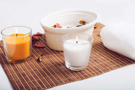 medium group of object: items for spa salon with two candles in foreground