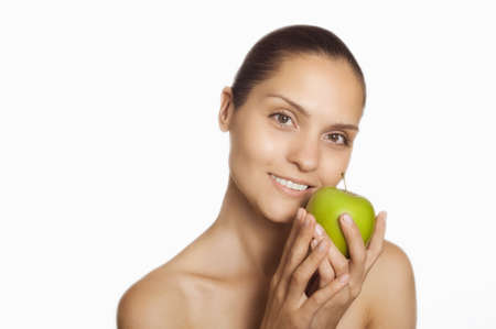 care about the health: adult girl holding a green apple in his hands