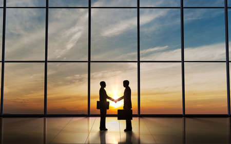 Two Business shake hand silhouettes rendered with computer graphic