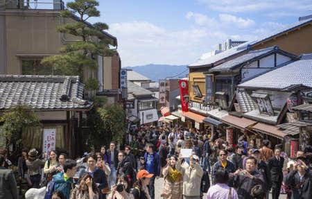 Tourists walk along the street to The Kiyomizu dera, Temple in Kyoto