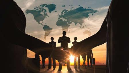 World business shake hand with teamwork silhouettes  Zdjęcie Seryjne