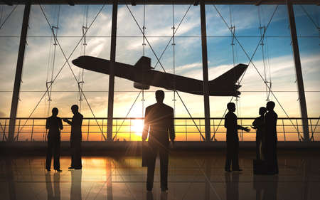 Business man standing and business group silhouette in the airport Stock Photo