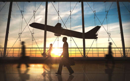 Business man walking silhouette in the airport photo