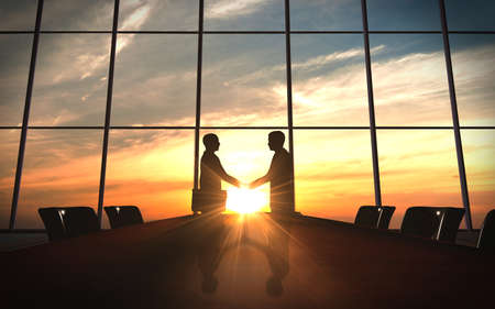 Two business shake hand in office silhouettes photo