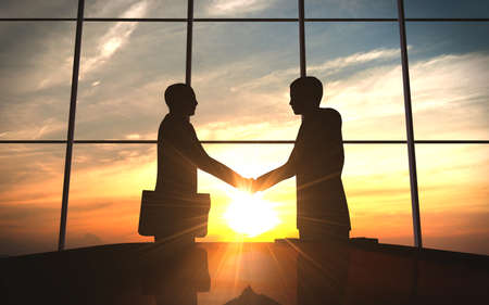 back lit: Two business shake hand in office silhouettes