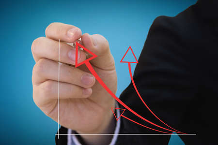 Business man drawing a red arrow  Stock Photo
