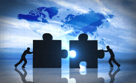 global strategy: World Business teamwork puzzle pieces