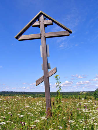 almighty: solitary cross on green field