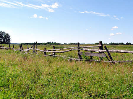 confined: old fence on autumn field Stock Photo