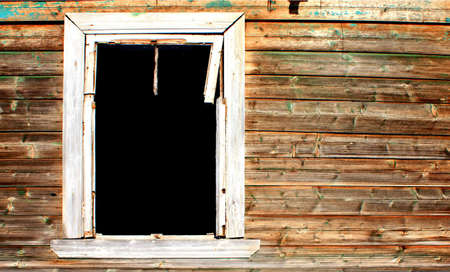 penal institution: window in abandoned wooden house Stock Photo
