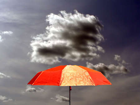 umbrella on background storm sky photo