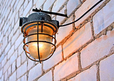 aging lamp on brick wall  photo
