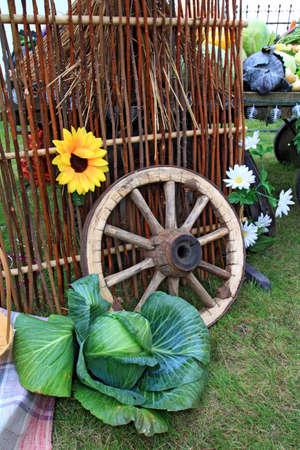 wooden wheel near fence  photo