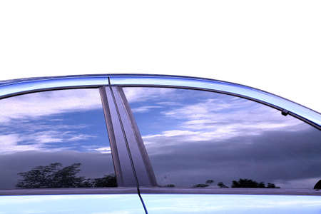 car window: reflection sky in glass of the car Stock Photo