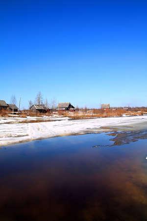 village on coast river photo