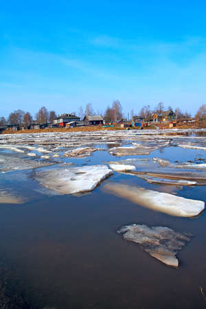 driving of ice on river photo
