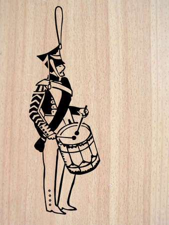parade:   illustration of the drummer on wood background