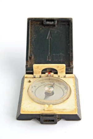 old compass on white background photo