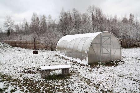 winter garden: plastic hothouse in winter garden Stock Photo