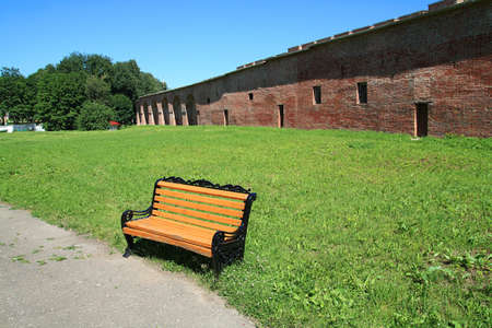 yellow bench in summer park photo