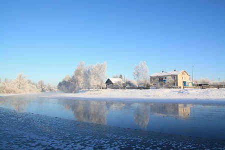 rural house amongst snow tree Stock Photo - 8636578